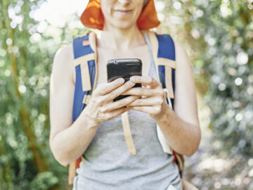 woman hiker consulting her smart phone