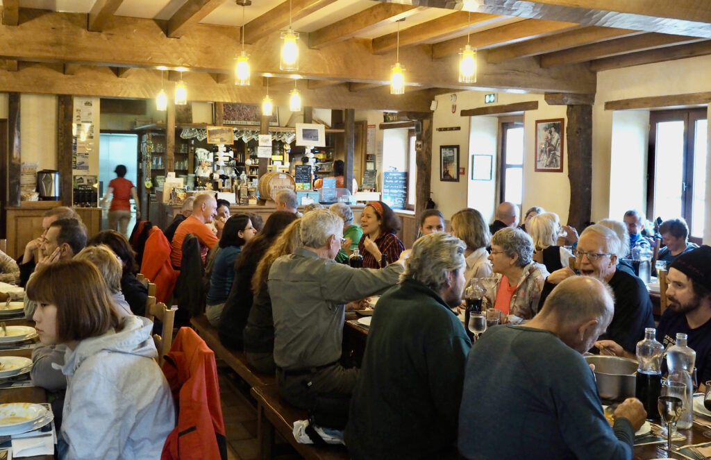 Orisson Refugio dining room filled with people eating a delicious and simple Camino supper