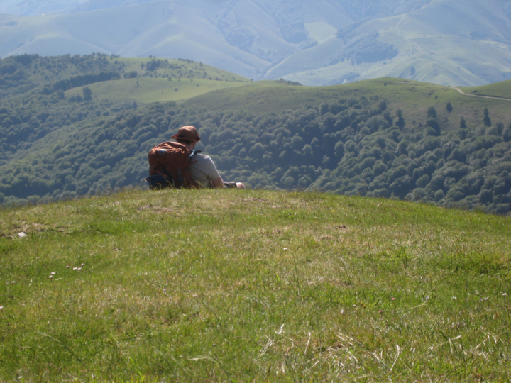 pilgrim sitting in the Pyrenees on the Camino