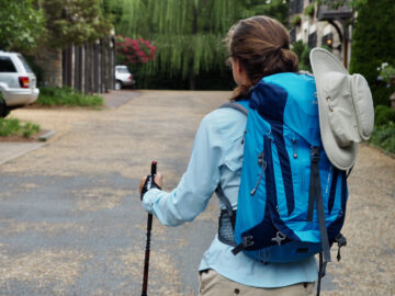 woman in hiking clothes with turquoise backpack