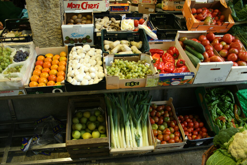 Fruits and vegetables on display at a stall in the Mercado de Abastos