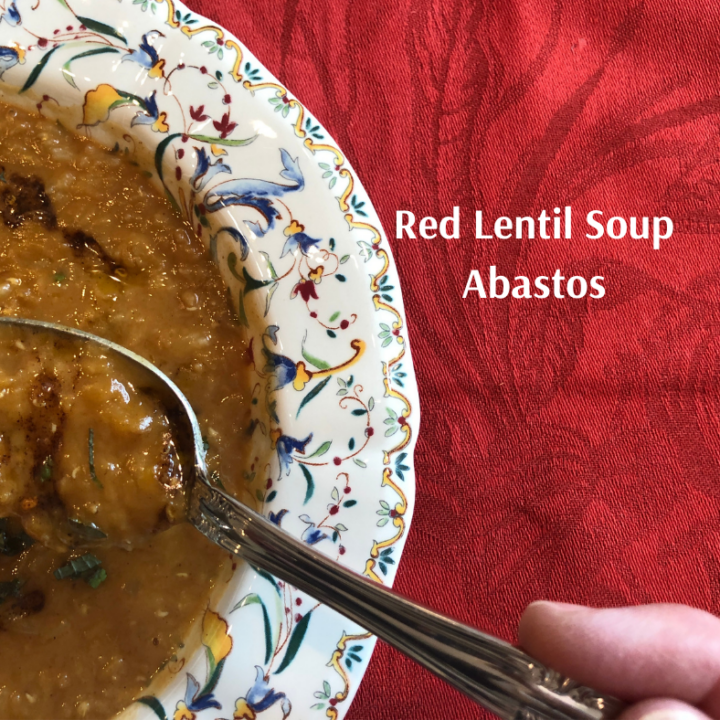 a bowl of Red Lentil Soup Abastos on a red tablecloth with spoon