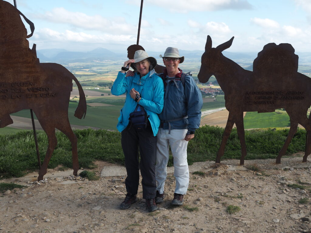 Helen and Wick in front of the pilgrim procession sculpture on the